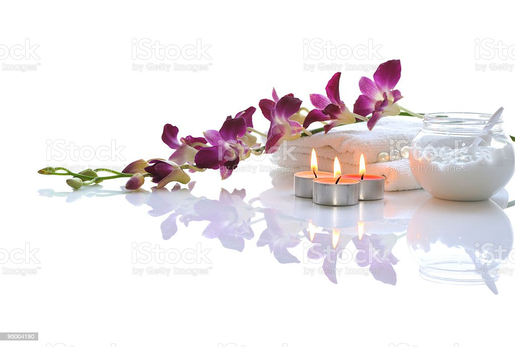 Flowers with candles and towels on white table stock photo