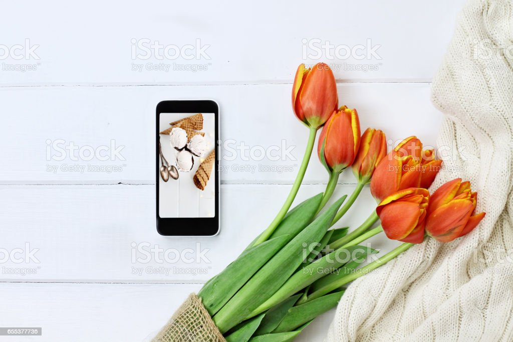 Flowers with Cell Phone and Ice Cream Photo stock photo