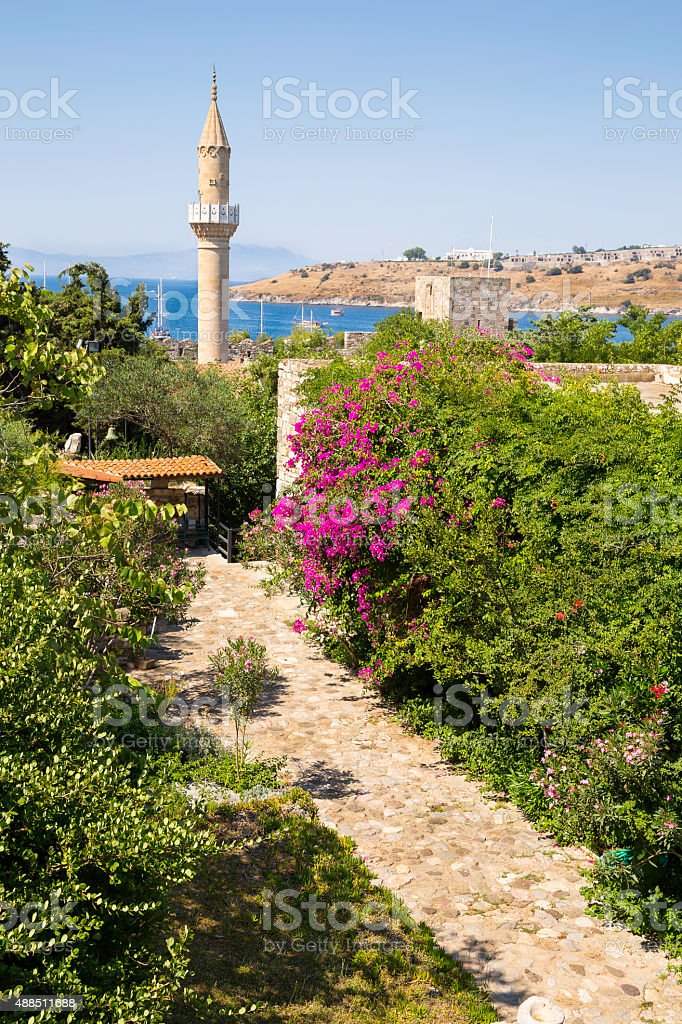 Flowery stone path and old historical Mosque in Bodrum Castle stock photo