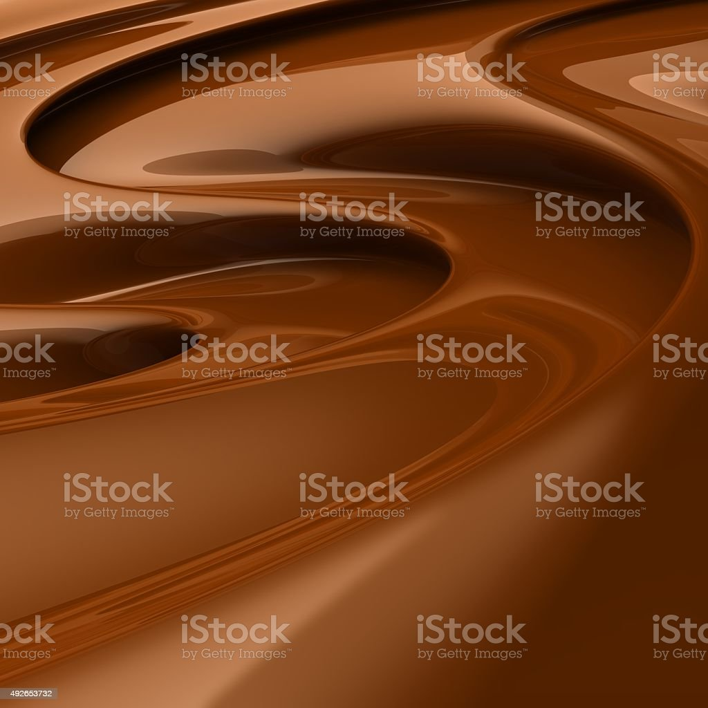 Flowing brown chocolate swirl stock photo