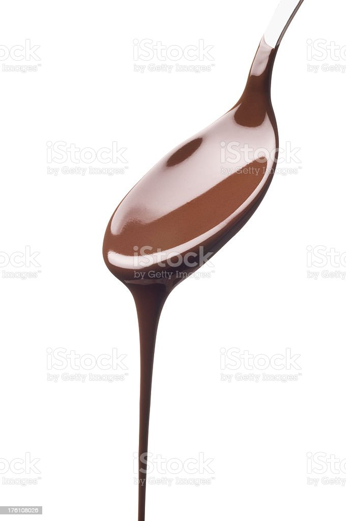 Flowing chocolate on a spoon stock photo