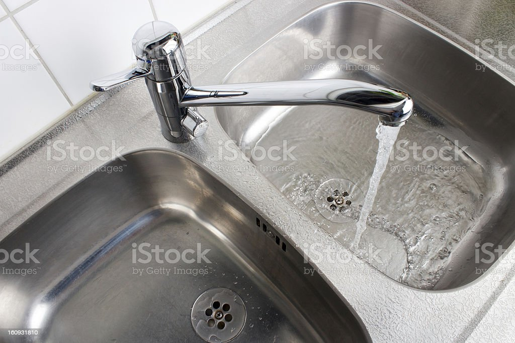 Flowing kitchen faucet royalty-free stock photo