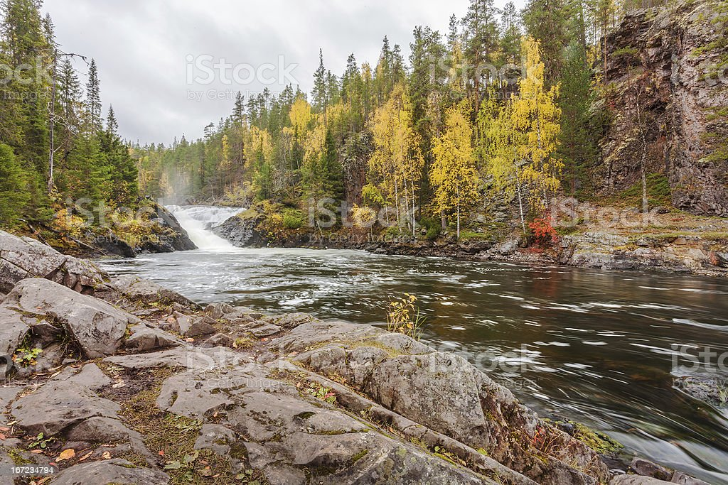 Flowing Lapland mountain river in autumn stock photo