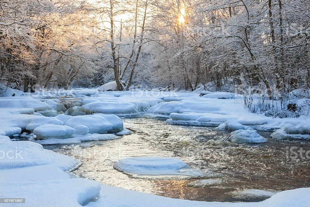 Flowing river in winter stock photo