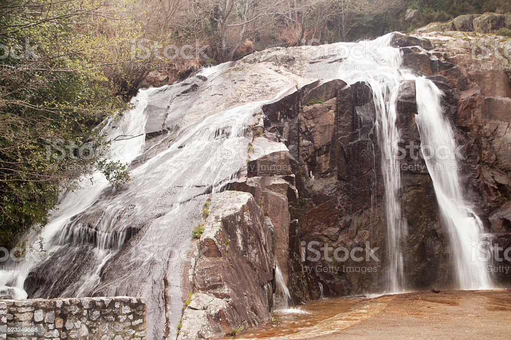 Flowing river, small waterfall stock photo