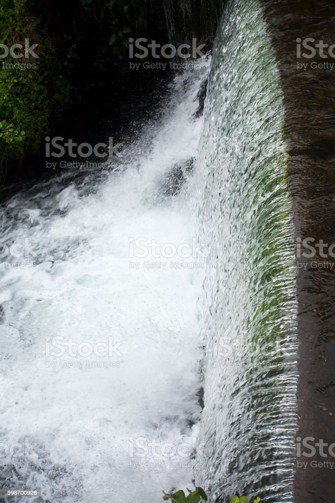 Flowing river, waterfall from above. stock photo