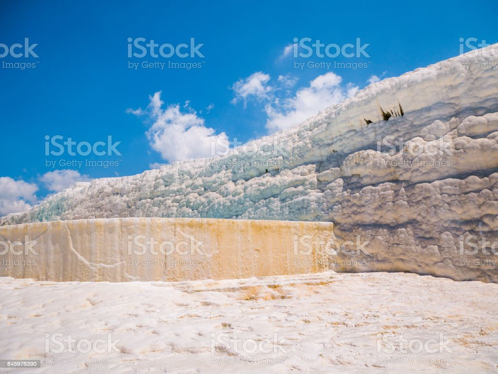Flowing slowly down the huge mountainside, mineral water collect in terraces, dripping over balconies of stalactites into milky pools. stock photo
