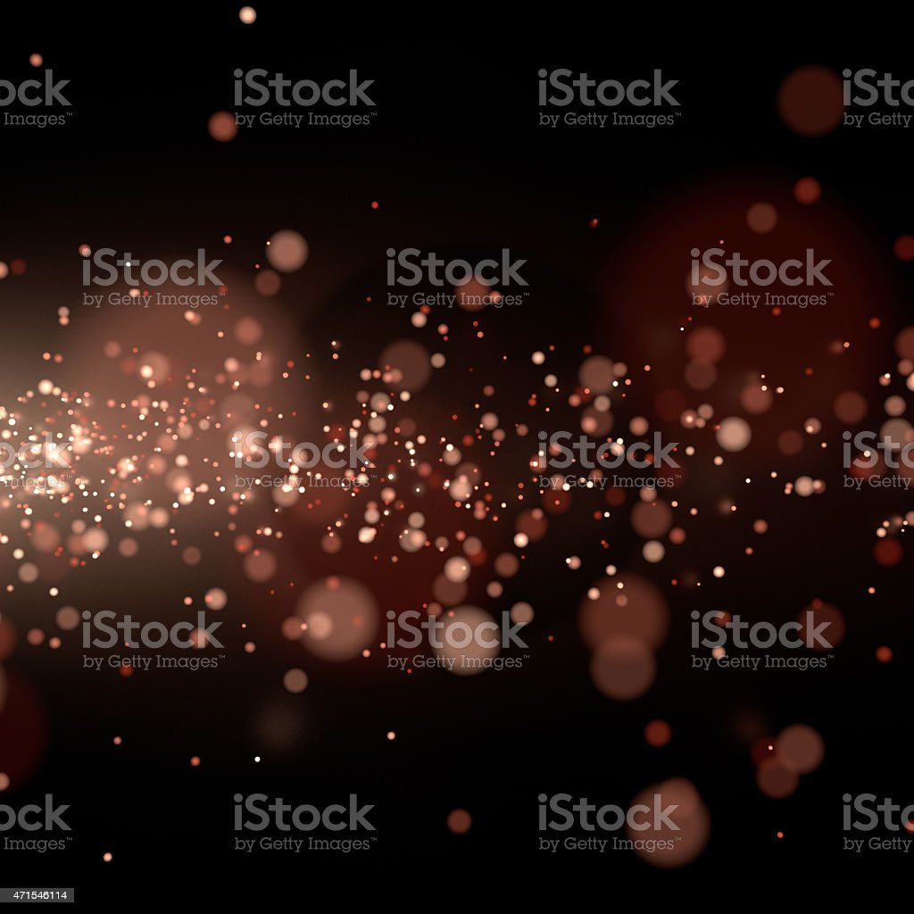 Flowing sparks in the dark stock photo