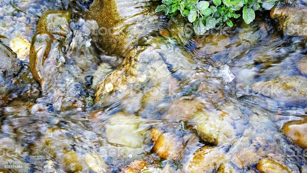 Flowing stream water stock photo