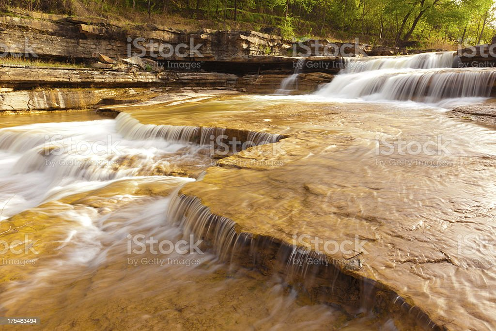 flowing water on the yellow rock royalty-free stock photo