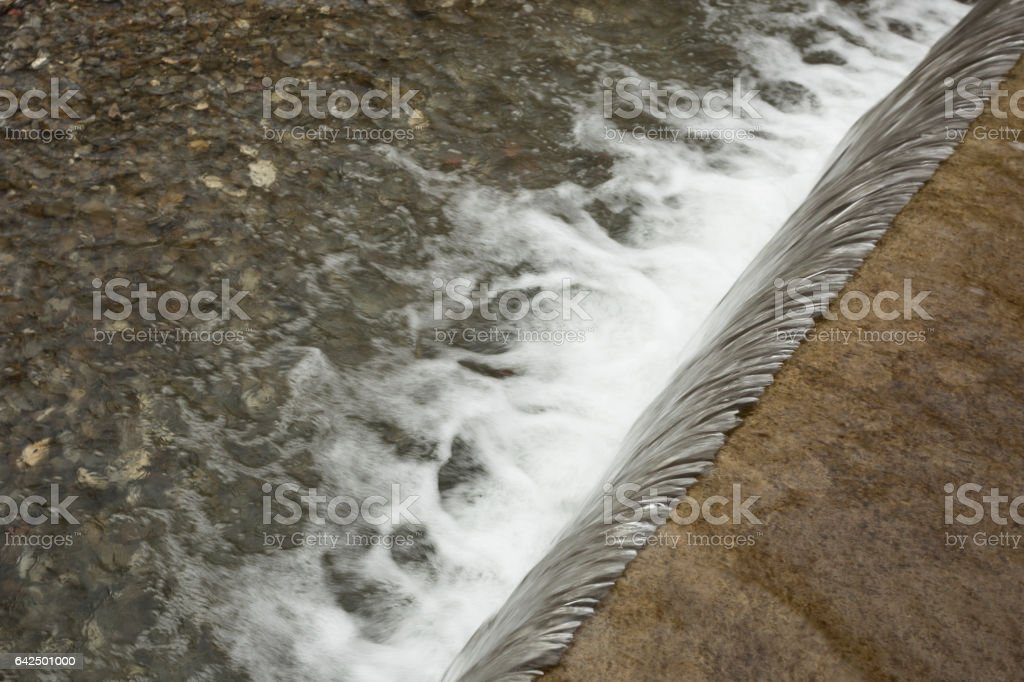 Flowing water over cascade. High angle view. stock photo