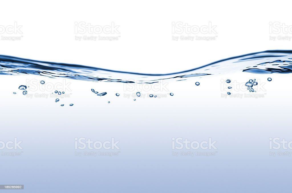 Flowing water with bubbles stock photo