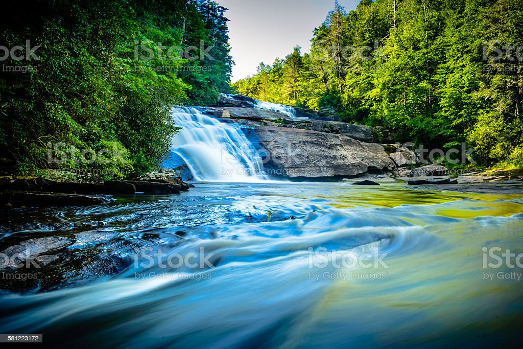 Flowing waters of Triple Falls at Dupont stock photo