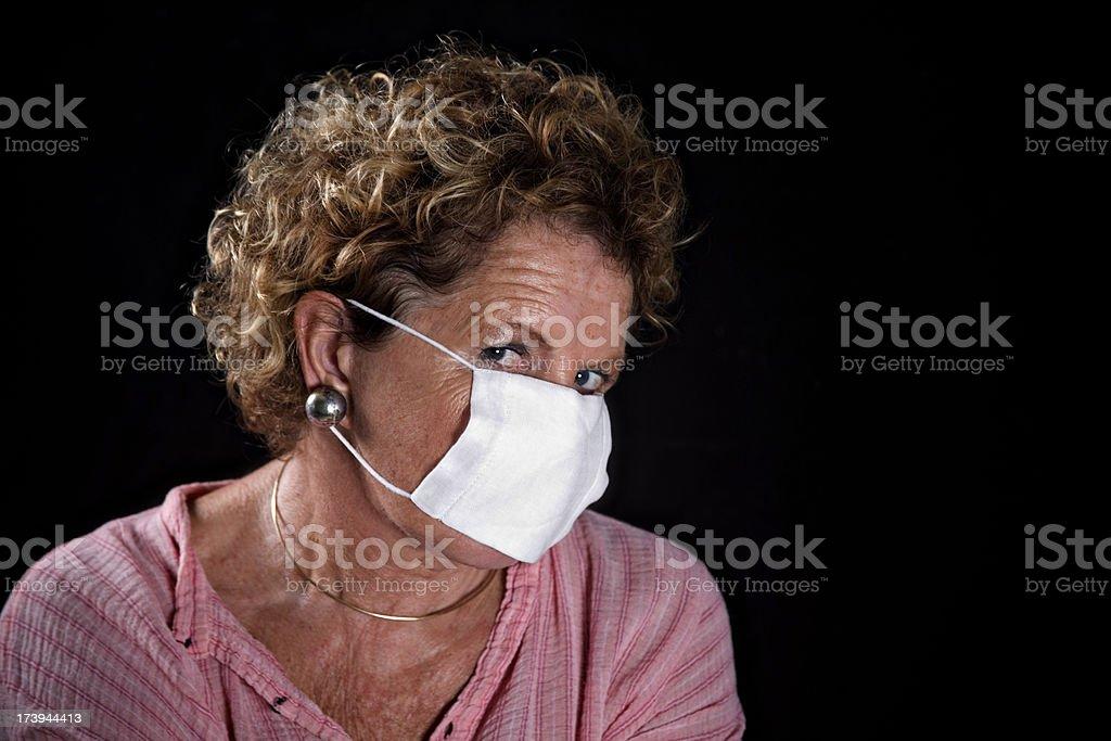 flu face mask on Senior woman stock photo