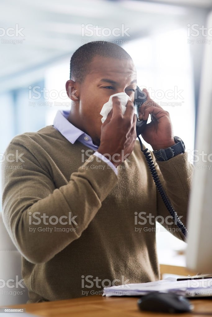 Flu germs have found their way into the office stock photo