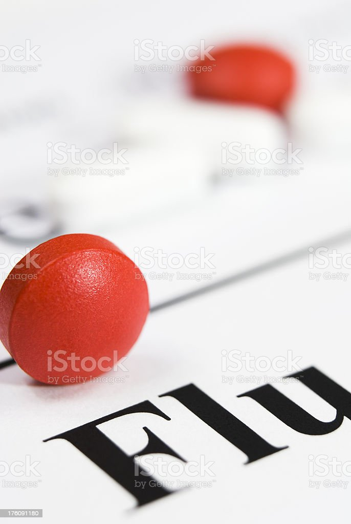 Flu health issue concept (red/white tablets/pills close-up) - VI stock photo