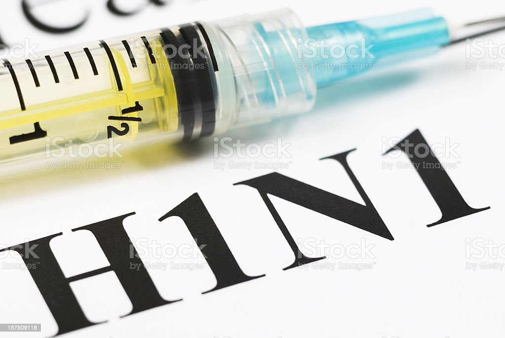 H1N1 Flu Shot, Vaccination close-up (cyan syringe) - II stock photo