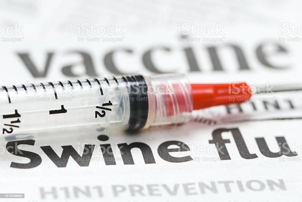 H1N1 Flu Shot, Vaccination headlines (red syringe) - IV stock photo