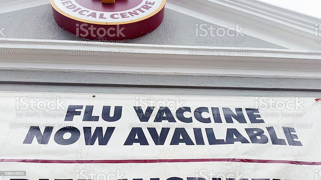 Flu vaccine sign, medical center, Cape Town, winter, editorial, stock photo