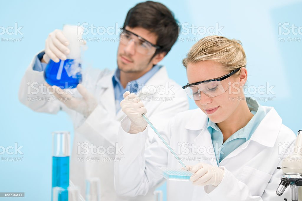 Flu virus experiment -  scientist in laboratory royalty-free stock photo