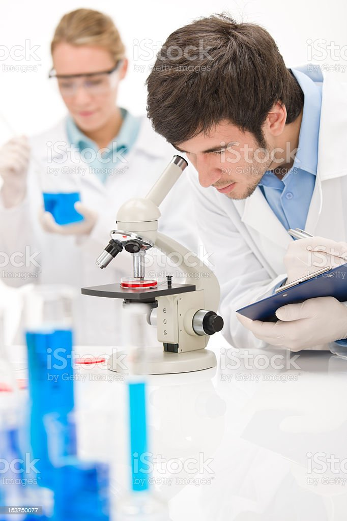 Flu virus experiment -  scientist in laboratory royalty-free stock photo