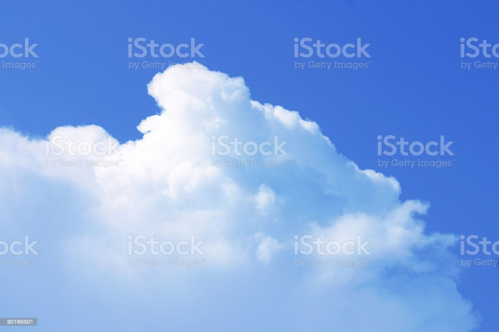 Fluffy, blue skies royalty-free stock photo