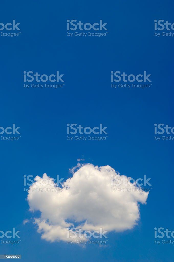 fluffy cloud in an otherwise clear blue sky royalty-free stock photo