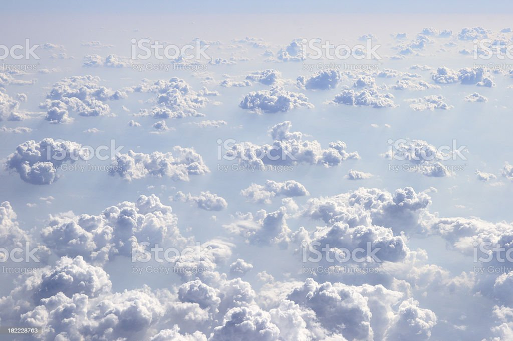 Fluffy clouds from above royalty-free stock photo