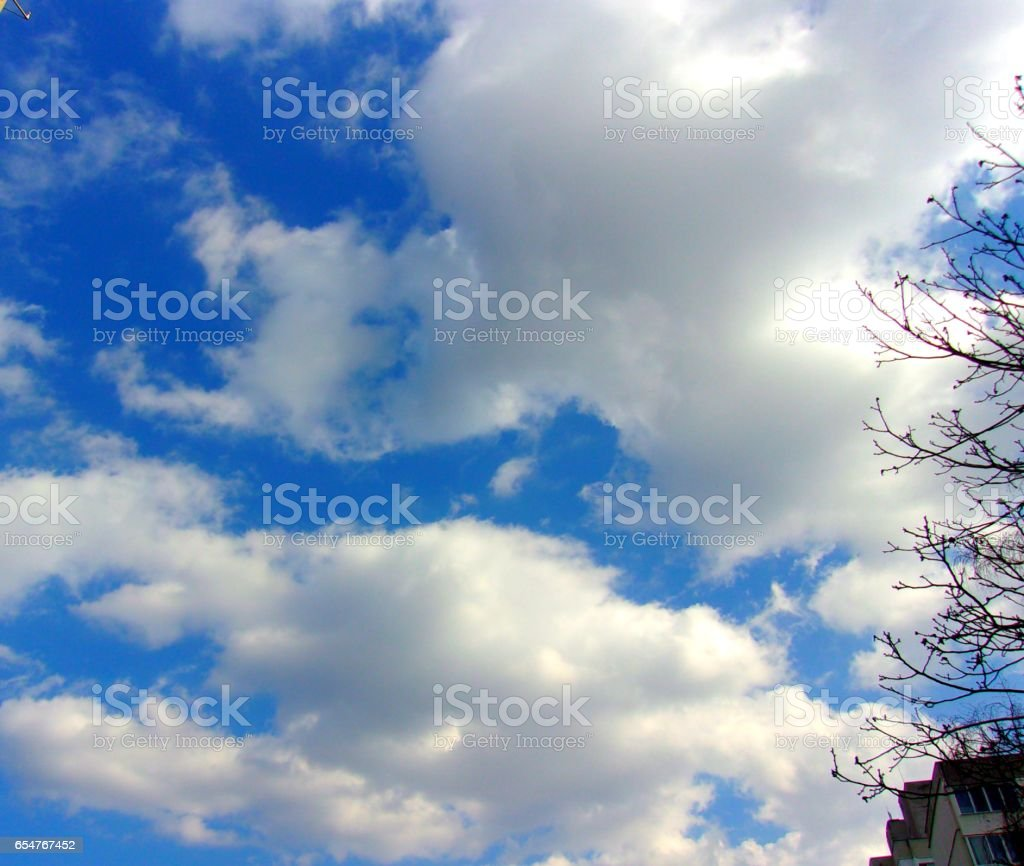 854- Fluffy clouds vibrant background stock photo