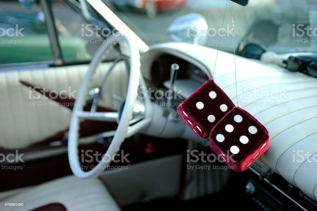 Fluffy dice in car stock photo