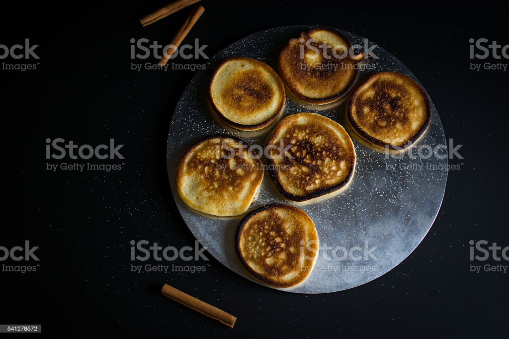 Fluffy Pan Cakes on silver from above on black stock photo
