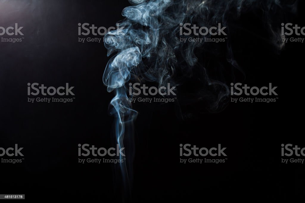Fluffy Puffs of Smoke and Fog on Black Background stock photo