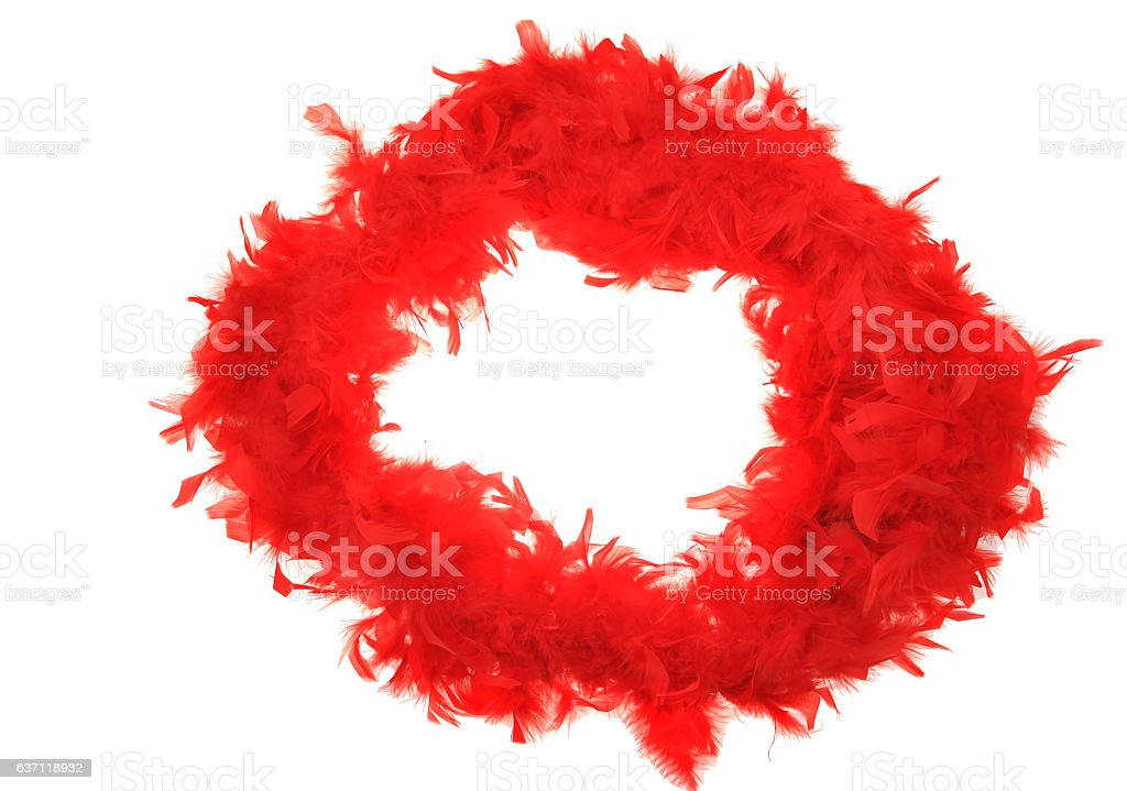 Fluffy red feather boa string on white stock photo