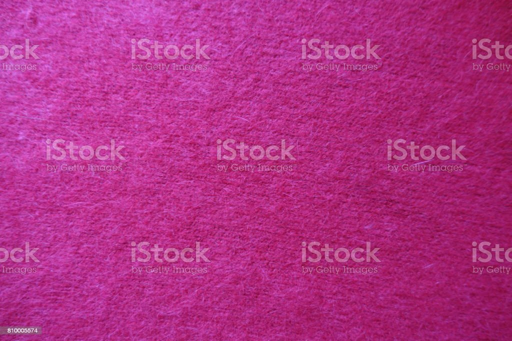 Fluffy scarlet red handmade stockinette knit fabric stock photo