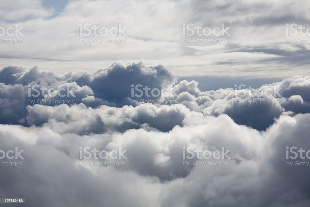 Fluffy white clouds from above stock photo