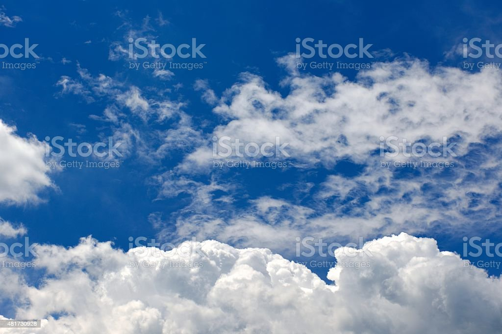 Fluffy White Cumulus Clouds and Blue Sky stock photo