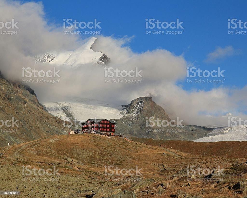 Fluhalp and snow capped Strahlhorn stock photo