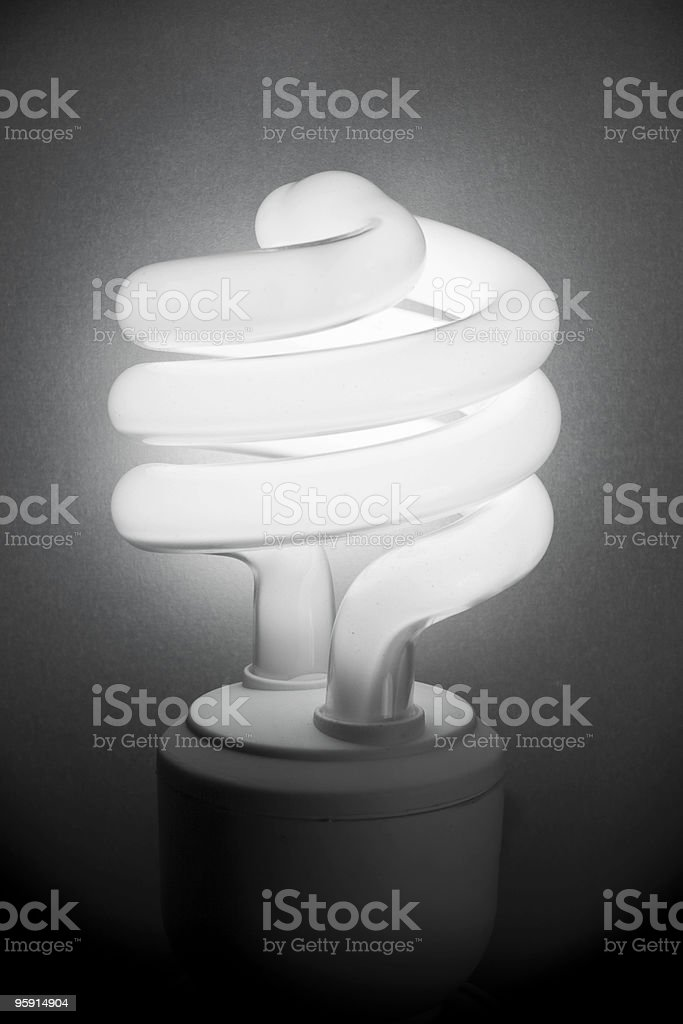 Fluorescence light bulb with grey background royalty-free stock photo