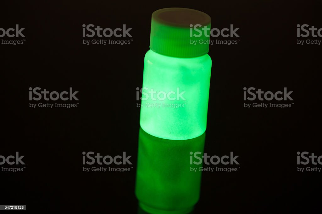 fluorescence material excited with UV light stock photo
