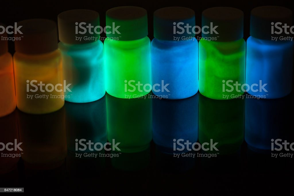 fluorescence materials excited with UV light stock photo