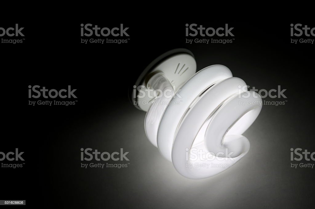 Fluorescent Light Bulb Illuminating Darkness stock photo