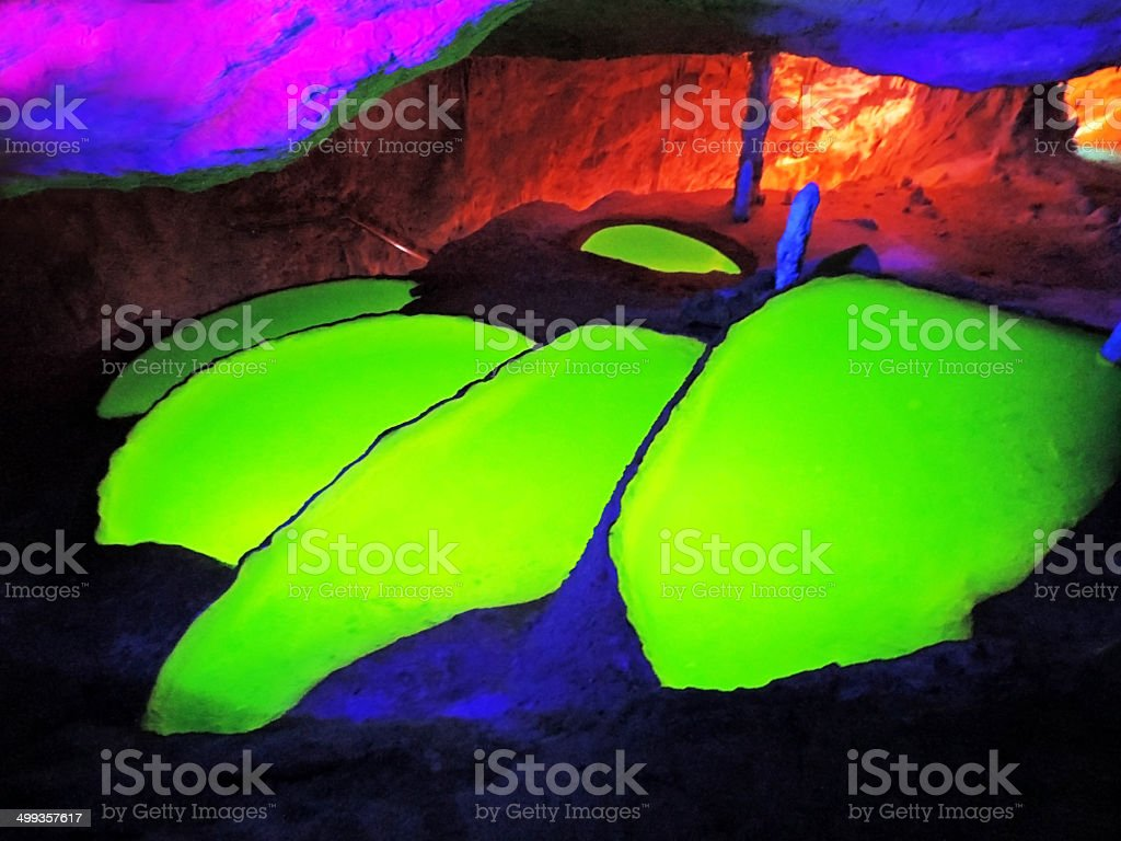 fluorescing cave stock photo