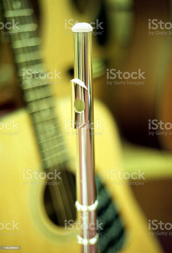 Flute and guitar stock photo