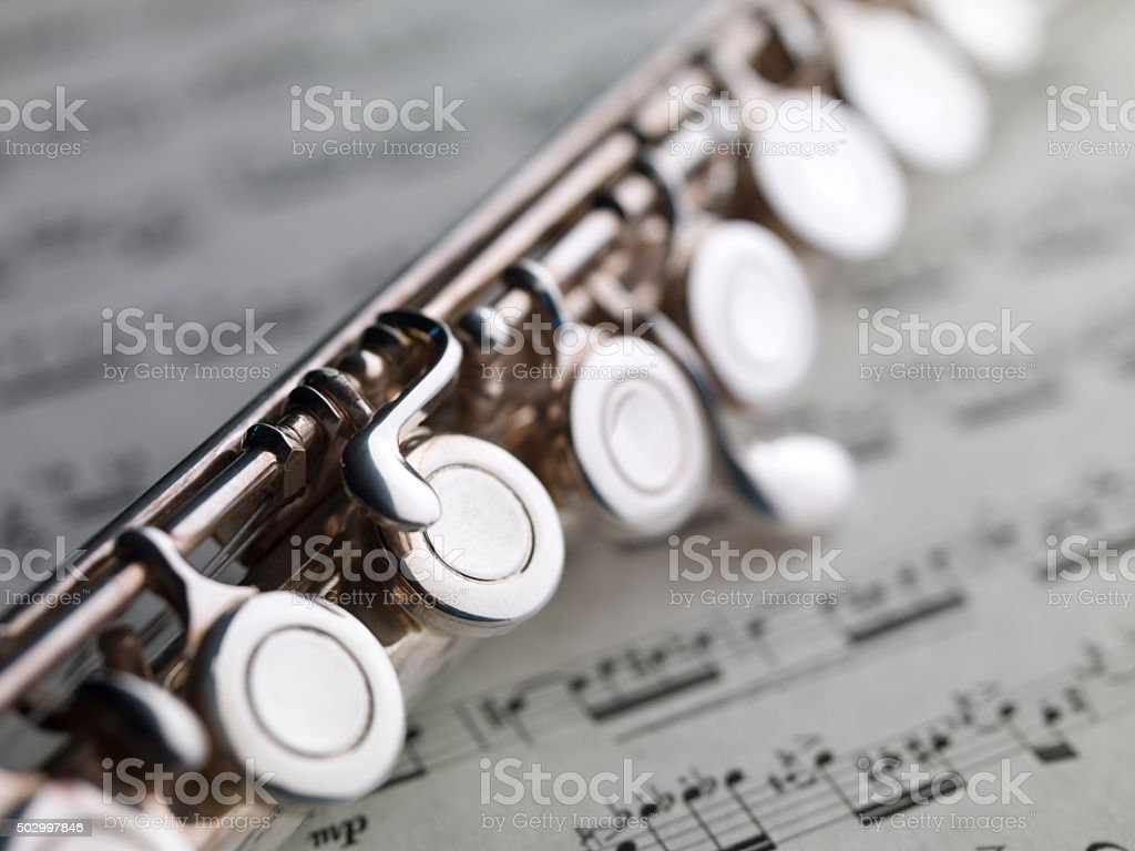 flute and music sheet, XIX century Puccini Aria stock photo