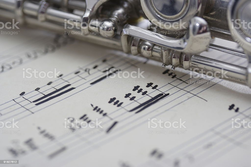 Flute and old sheet music royalty-free stock photo