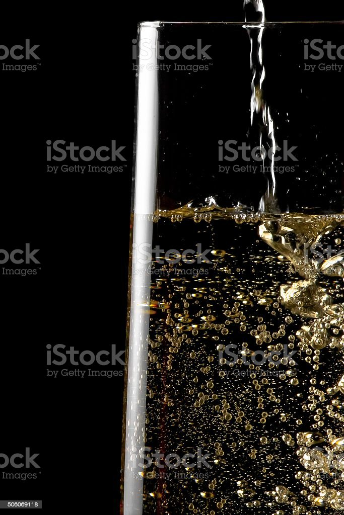 flute of champagne with golden bubbles stock photo