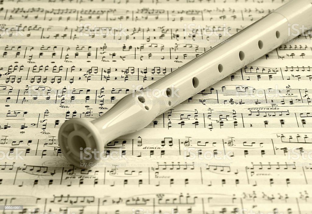 Flute on a music sheet royalty-free stock photo