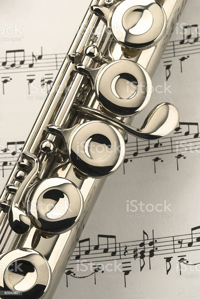 Flute on music sheet royalty-free stock photo