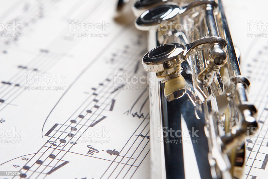Flute on Sheet of Music royalty-free stock photo