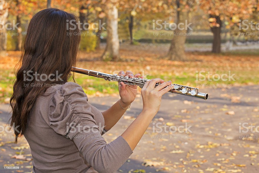 Flute player stock photo